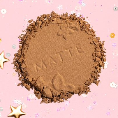 Physicians Formula | Matte Monoi Butter Bronzer - Product swatch, with confetti and pink background
