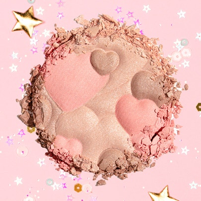 Physicians Formula | Happy Booster Glow & Mood Boosting Blush - Product swatch, with confetti and pink background