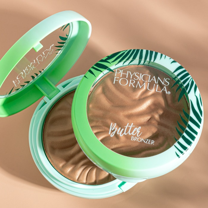 Murumuru Butter Bronzer | Phsicians Formula | Products angled lid open and one closed, with tan background
