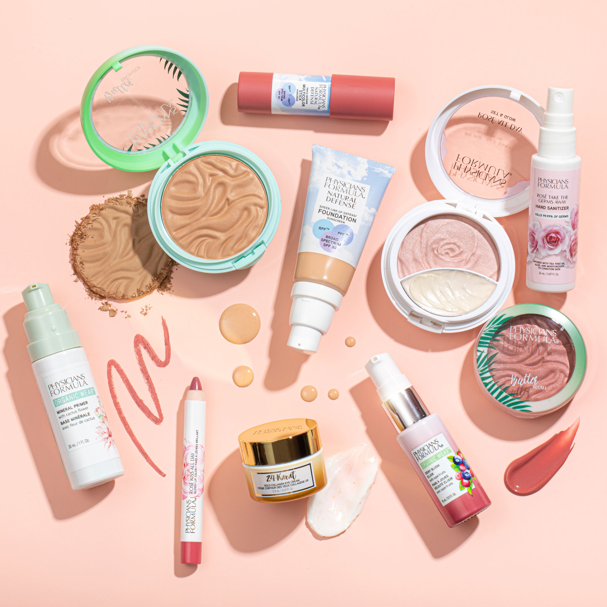Phyisicans Formula products scattered, with swatches and pink background