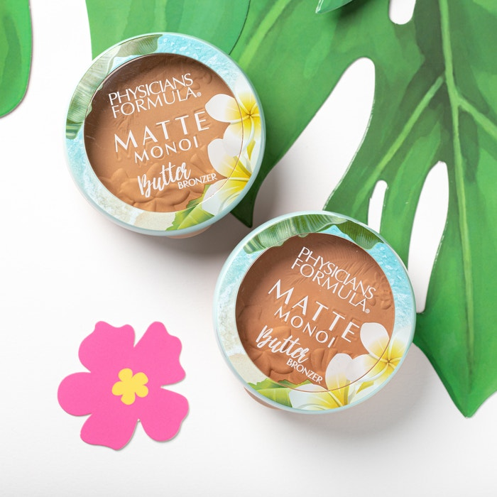Matte Monoi Butter Bronzer | Physicians Formula | Productsangled lid closed, with flower, leaf and white background