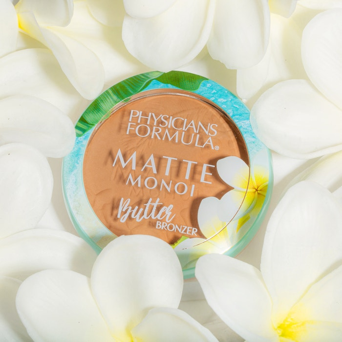 Matte Monoi Butter Bronzer | Physicians Formula | Product front facing lid closed, with flowers and white background