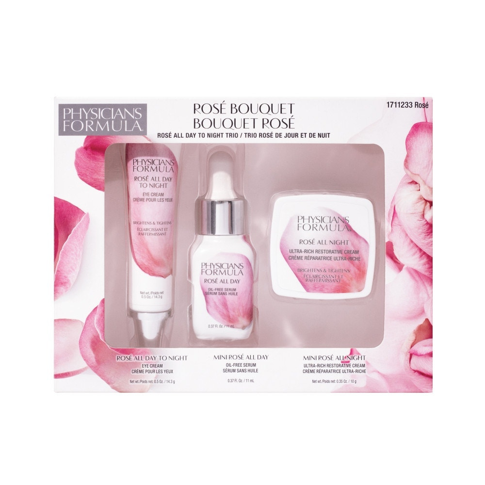 Rosé Take the Germs Away Hand Sanitizer   Physicians Formula   Product angled cap removed, with flowers and reflection in background