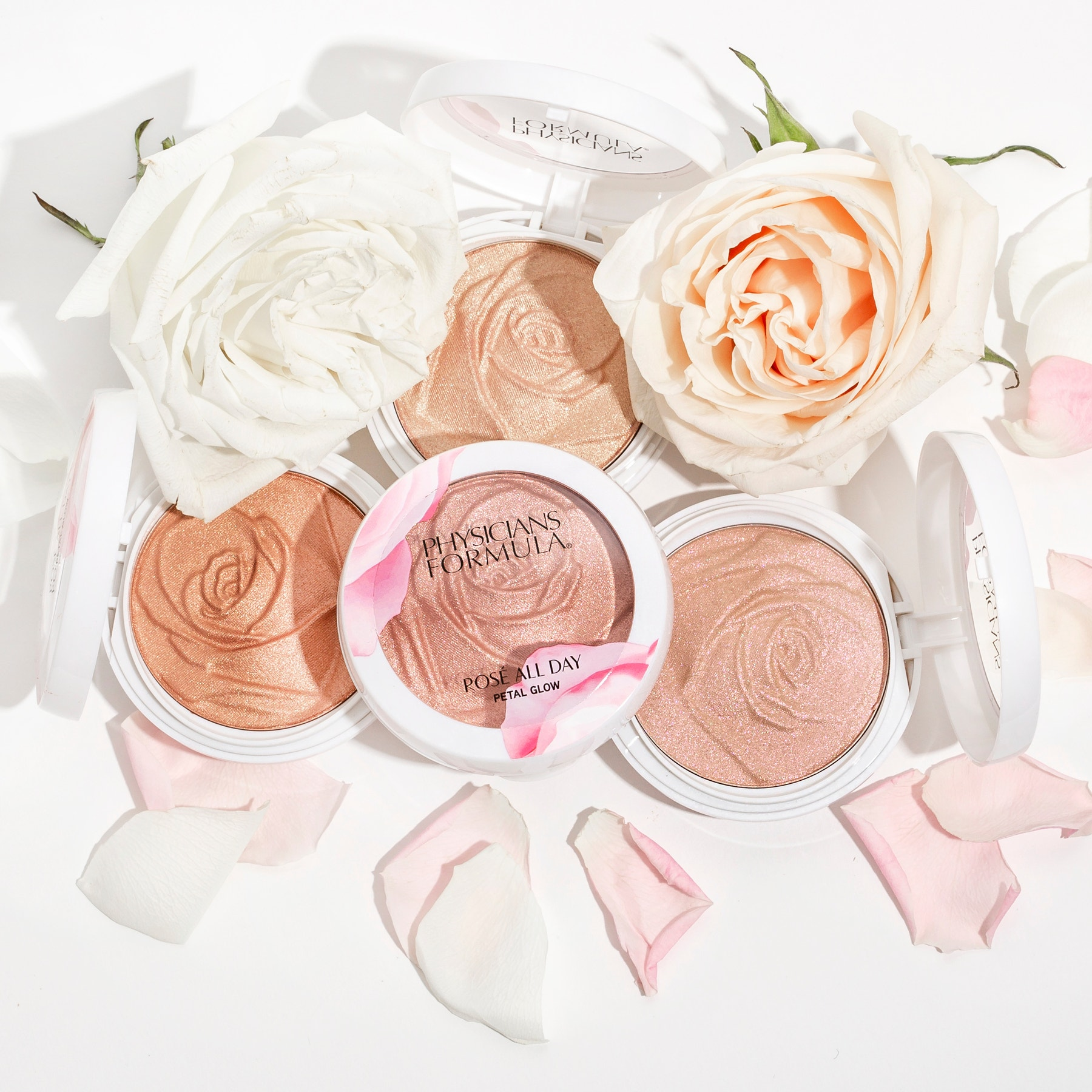 Rosé All Day Petal Glow | Phsicians Formula | Products front facing lids open, with roses and white background